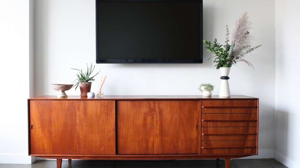 Wall mounted tv in mid century modern furnished apartment picture id856411420