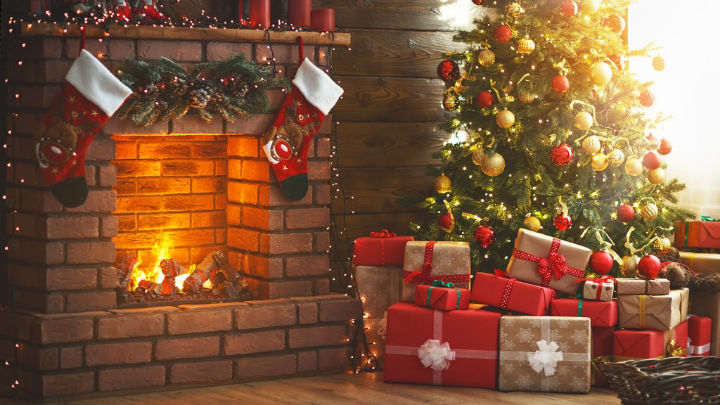 Interior christmas magic glowing tree fireplace gifts picture id873180722