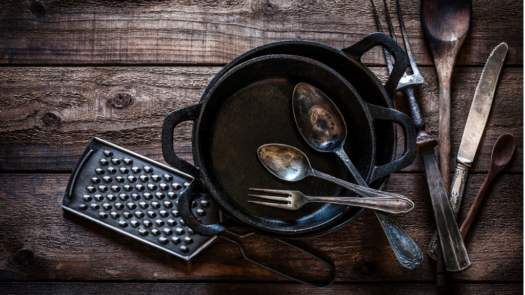 Vintage kitchen utensils shot from above on rustic wooden table picture id912245274