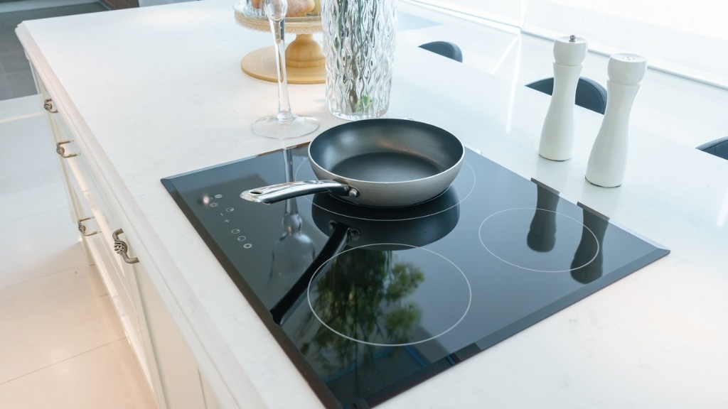 Frying pan on modern black induction stove cooker hob or built in picture id916807096